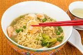 Постер, плакат: Eating Shrimp And Noodles Soup