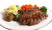 stock photo of t-bone steak  - A dinner of a Porterhouse  - JPG