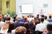 foto of entrepreneurship  - Speaker Giving a Talk at Business Meeting - JPG