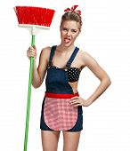 stock photo of broom  - Cleaning woman standing unpleasant while spring cleaning with broom  - JPG
