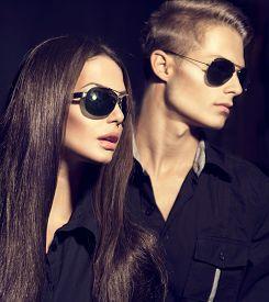 image of dark-skin  - Fashion models couple wearing sunglasses - JPG