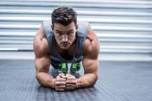 image of day care center  - Portrait of a muscular man on plank position - JPG
