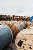 image of coil  - Wooden Coils Of Electric Cable Outdoor - JPG