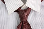 foto of tied  - The tie tied in knot round a shirt collar - JPG