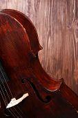 image of cello  - Vintage cello on wooden background - JPG