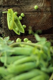 picture of pea  - open green peas on old wood - JPG