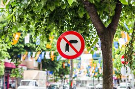 stock photo of traffic rules  - Traffic sign prohibiting right turn on red traffic light - JPG