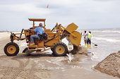 Dumping Sand To Be Sifted By Hand