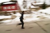 A motion blur abstract of a person walking in a hurry, a late rushing concept image. poster