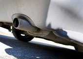 An old exhaust pipe on a car