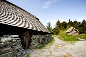 stock photo of longhouse  - An old norwegian viking farm with two typical buildings - JPG