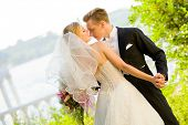 image of wedding couple  - Colorful wedding shot of bride and groom dancing - JPG