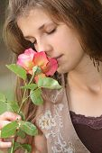 Beautiful Girl Smelling Rose