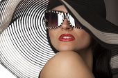 pic of superstars  - Portrait of beautiful model in striped hat with glasses - JPG