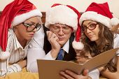pic of promiscuous  - Manager with two his subordinates reading a business plan on New Year - JPG