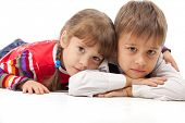 stock photo of gullible  - Two kids looking at something  - JPG
