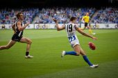 MELBOURNE - APRIL 2: North Melbourne's Sam Wright kicks during their loss to Collingwood at Etihad S