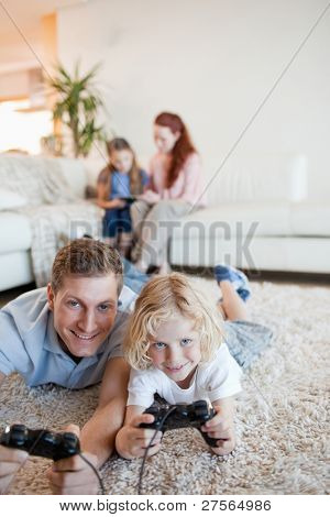 poster of Father and son enjoying video games together in the living room