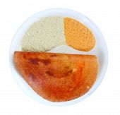 stock photo of urad  - Masala dosa with different types of chutney on a plate - JPG