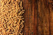 Top View Wholemeal Pasta Fusilli Raw Organic Whole Grain On A Rustic Wooden. Whole Wheat Pasta poster