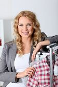Beautiful woman in garment store