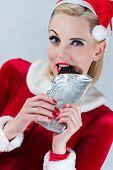 Girl eating Christmas chocolate