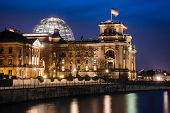 Illuminated Neo-Renaissance  Reichstag Building, one of the best known landmarks of Germany and seat poster
