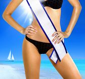 stock photo of beauty pageant  - part of woman shape in underwear with white tape of beauty contest - JPG