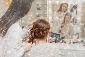 Beautiful Girl With Long Red Hair, Braided With A Braid, In A Beauty Salon On The Background Of Snow poster
