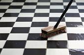 scrubber on wet tiled floor