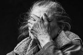 Very Old And Tired Wrinkled Woman Outdoors poster