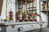 Three Phase Oil Immersed Transformer Under Induced Over Voltage Test, Focusing On Lv Terminals Which poster