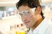 Portrait of a smiling young researcher inside his laboratory