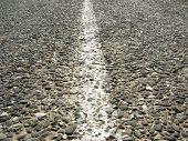 old asphalt road with median strip