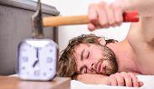 Man Bearded Annoyed Sleepy Face Lay Pillow Near Alarm Clock. Guy Knocking With Hammer Alarm Clock Ri poster