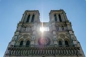 Noon Glaring Sun Rays Through Notre-dame Facade poster
