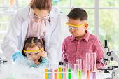 Science Teacher Teach Asian Students In Laboratory Room, Smoke Float Out Of Bowl, They Excited, Colo poster