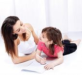 Woman And Child Drawing On Notepad
