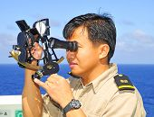 Navigation Officer Manages Sextant