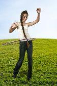 pic of hulahoop  - Young teenage woman with a hula hoop - JPG