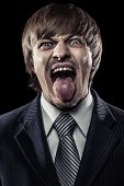 Young Businessman Shouting With His Tongue Stuck Out