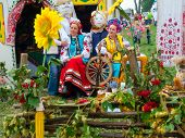 SUMY, UKRAINE - SEPTEMBER 22: Women wearing historical costume posing in traditional village background on annual agro exhibition SUMY-2012 on September 22, 2012 in Sumy, Ukraine