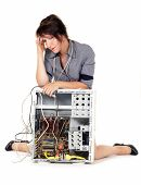 worried woman with her damaged computer