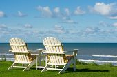 image of lawn chair  - two chairs on a meadow with a view on the sea - JPG