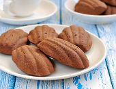 Madeleine cookies on a blue table
