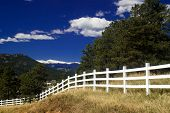 White Rural Picket Fence In Colorado