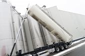 stock photo of silo  - tanker truck refilling some large silos for food industry - JPG