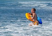 foto of boogie board  - Boogie boarding boy running in surf and water - JPG