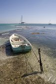 Small Boat Near The Shore On Ambergris Caye, Belize