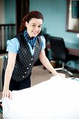 Beautiful Smiling Attendant Holding Sheet, Redoing Room